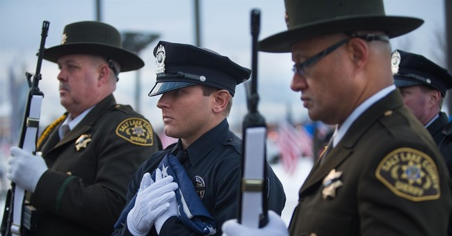 Slain officer called loving, talkative by wife, colleagues