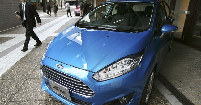 Ford blames market conditions, pulls out of Japan, Indonesia