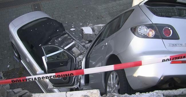 Germany: driver rams through car park wall, falls 10 feet