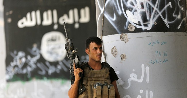 IS loss of border area with Turkey sharply harms group