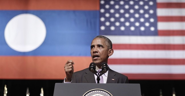 Pledging US help, Obama says Laos living in 'shadow of war'
