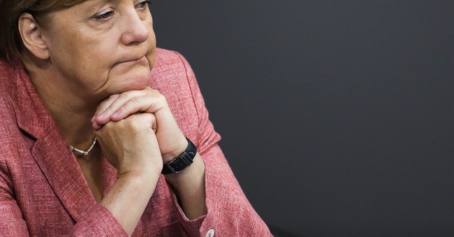 Merkel aide urges unity after German state election defeat