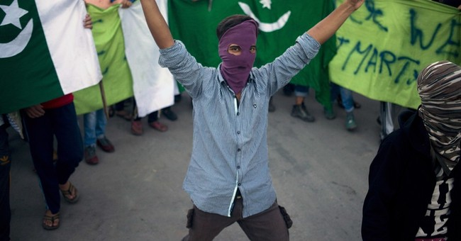 In death, a Kashmir rebel becomes what India has long feared