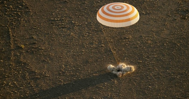 Happy landings: 3 space station crew members back on Earth