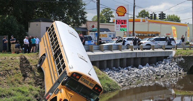 Minor injuries when school bus runs onto bank of canal