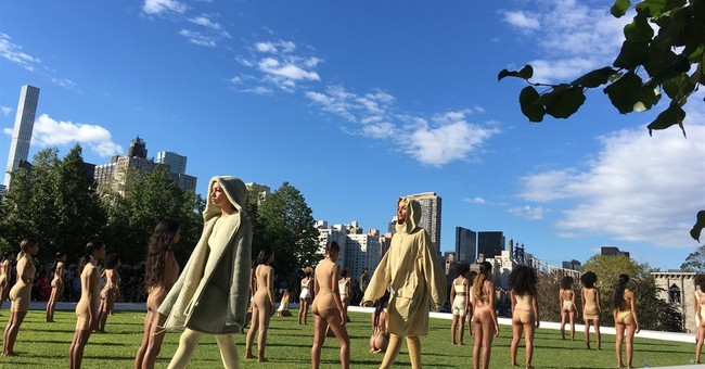 Sweaty fashion crowd lured outside for Kanye West show