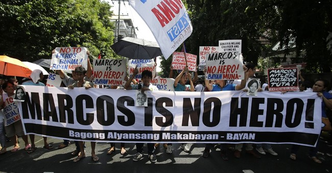 Philippine gov't defends decision on hero burial for Marcos
