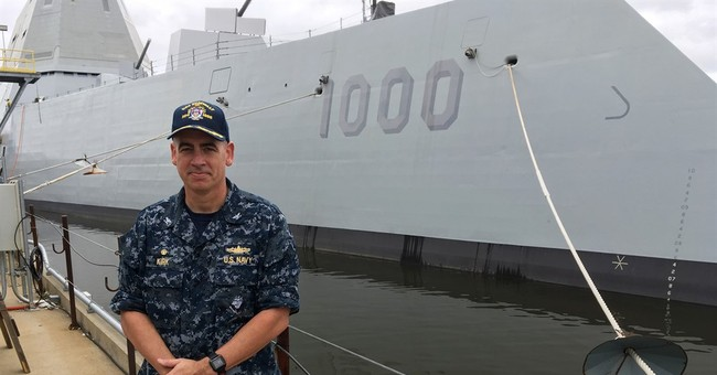 The Latest: Stealthy destroyer sets sail to join US Navy