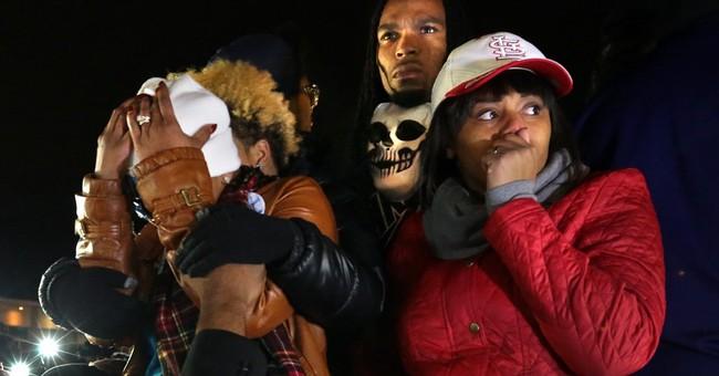 Police probe shooting death of Ferguson activist Seals