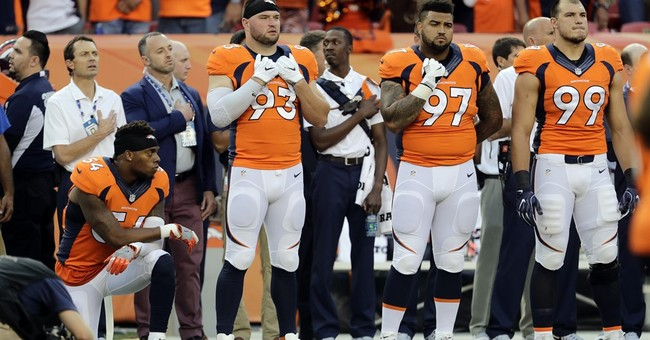 Denver LB Brandon Marshall takes a knee during anthem