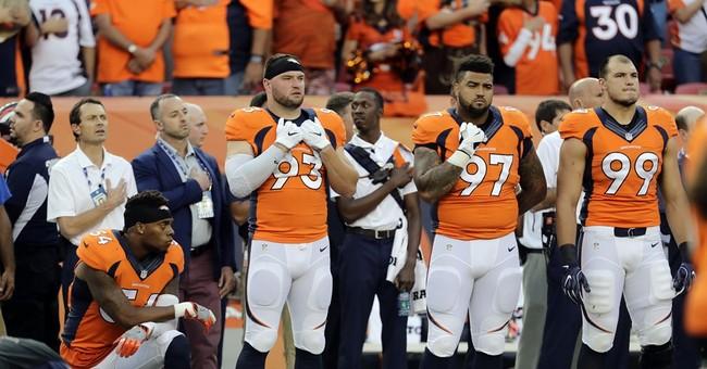Denver LB Brandon Marshall takes a knee during anthem