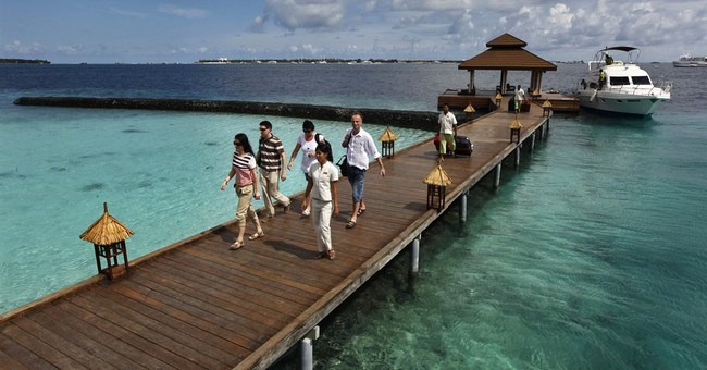 Maldives police raid newsroom after documentary broadcast