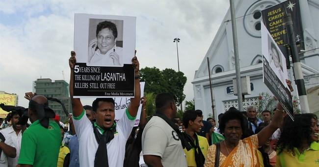 Sri Lankan court allows exhumation of slain editor's remains