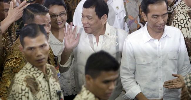 Philippines' Duterte tells Obama he never cursed him