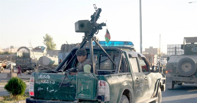 Official: Afghan forces take back city threatened by Taliban