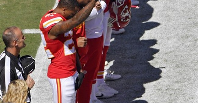 KC's Peters raises fist, 4 Dolphins kneel during anthems
