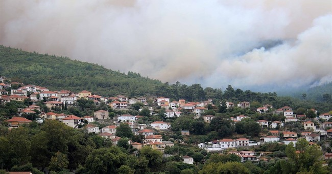 Prime minister visits Greek island hit by damaging wildfires