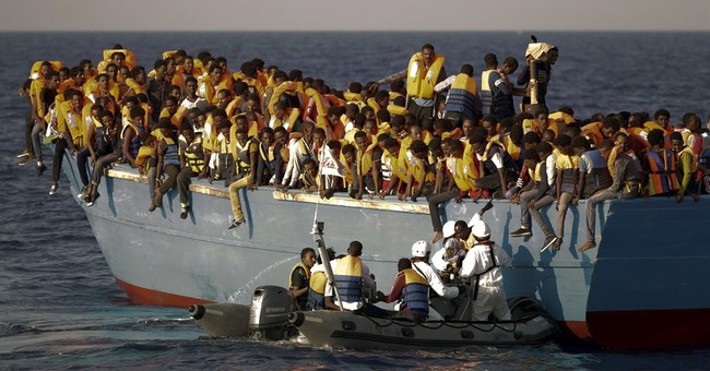 The Latest: Rescue ship recovers bodies of 5 dead migrants