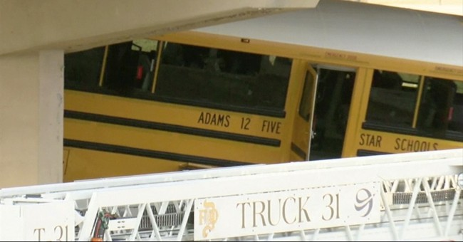 The Latest: Somber homecoming at school after bus crash