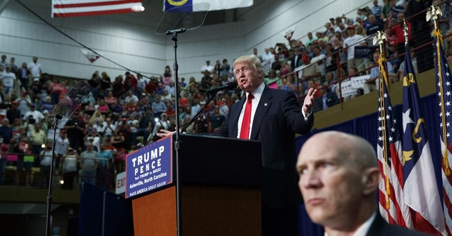Trump stands up for backers even as rally scuffle breaks out
