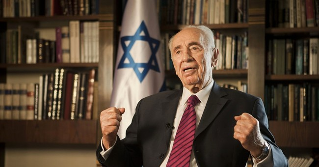 The Latest: Doctor treating Peres says he is conscious