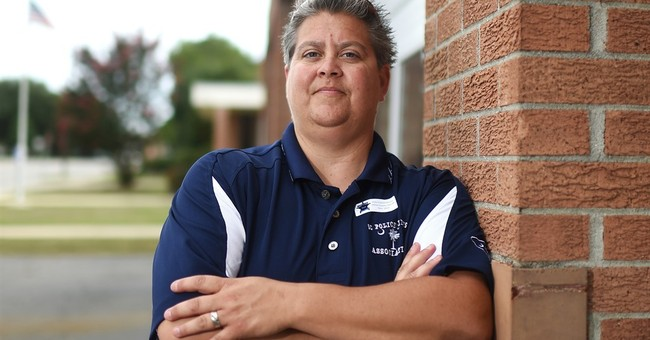 Lawyer for gay police chief says she was fired illegally