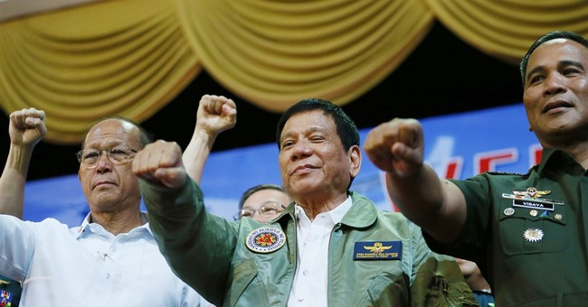 Philippine leader rejects joint patrols, eyes China weapons