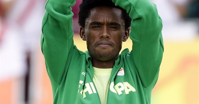 Ethiopian marathoner remains in US on visa after protest