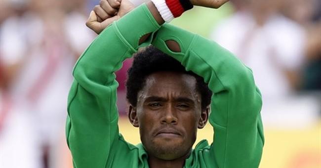 Ethiopian marathoner remains in US on visa after protest