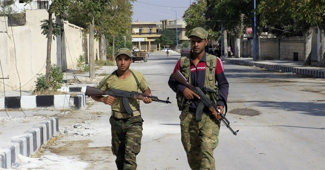 Syrian military begins to withdraw from vital Aleppo road