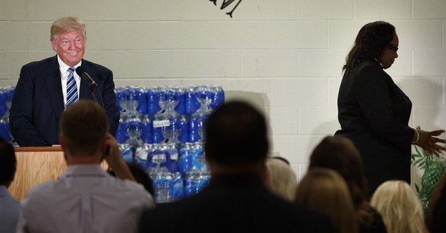 Trump, interrupted, heckled in visit to Flint church