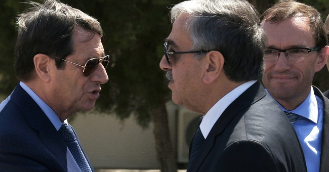 Split Cyprus' rival leaders to meet UN chief on peace talks