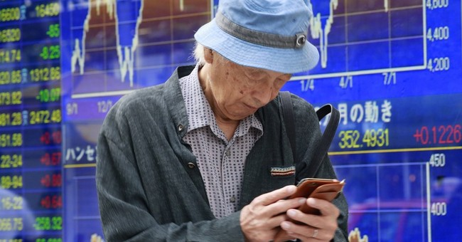 Asian markets lower after Wall Street decline
