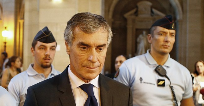 French tax fraud trial portrays example of 'world plague'