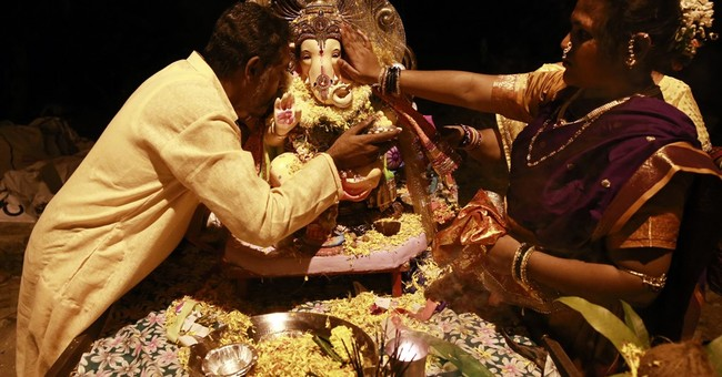 India's bustling Mumbai slows for festival to honor Ganesha