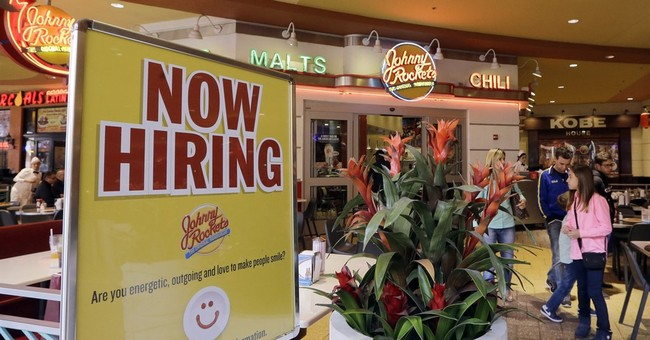 Applications for US jobless benefits rose slightly last week