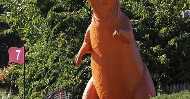 Orange dinosaur at mini golf course saved from extinction