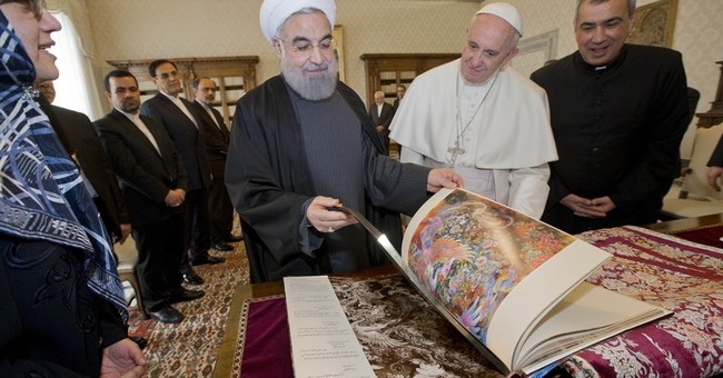 Iranian leader gives pope rug, wants Francis to pray for him