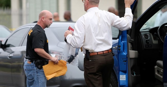 The Latest: Suspect in deputy shooting appears in court
