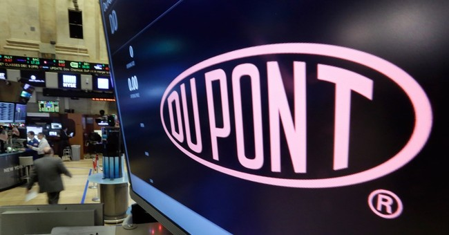 DuPont reports 4Q loss, steps up cost cuts ahead of Dow deal