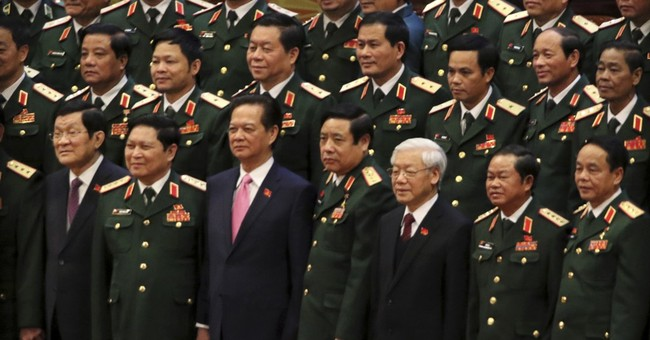Vietnam ruling party boss re-elected, cements hold on power