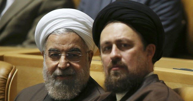 Iran signs flurry of business deals as leader visits Europe