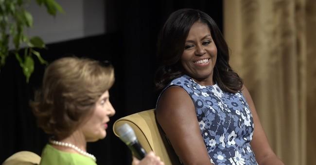 Michelle Obama makes campaign trail debut for Clinton
