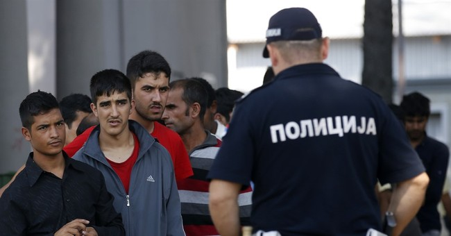 More migrants stuck in Balkans as nations fortify borders
