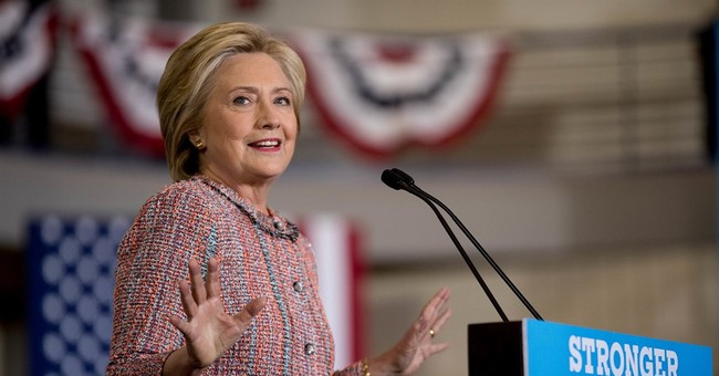 After summer of attacking Trump, Clinton focuses on herself