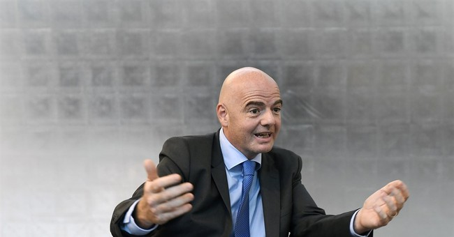 AP Interview: Infantino fighting resistance to overhaul FIFA
