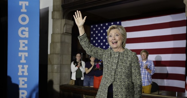 Clinton says Trump gives 'aid, comfort' to ISIS recruiters