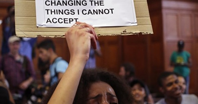 South Africa says OK to university fee hikes, amid protests