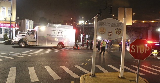 The Latest: Man being sought lived in apartment FBI searched