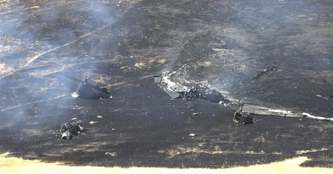 The Latest: Air Force identifies pilot who died in U-2 crash